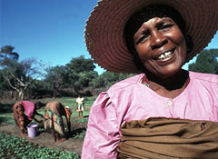 A happy and healthy lady working in the fields
